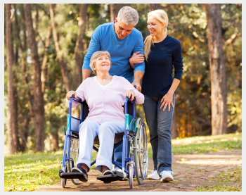 Caregivers and senior at the park